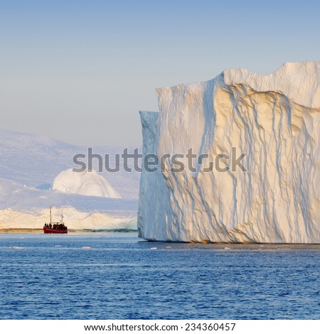 Greenland. The biggest glacier on a planet Jakobshavn. Huge icebergs of different forms in the gulf. Studying of a phenomenon of global warming and catastrophic thawing of ices. - stock photo