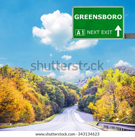 GREENSBORO road sign against clear blue sky - stock photo