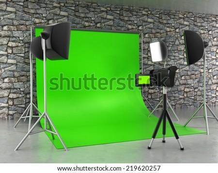 Greenscreen studio setup with lights and lightbox. - stock photo