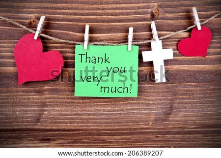 Greent Tag with Hearts and Cross on a Line with the Words Thank You Very Much - stock photo