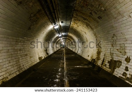Greenwich foot tunnel in London, UK - stock photo