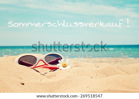 greeting card background - beach holidays - german for summer sale - stock photo