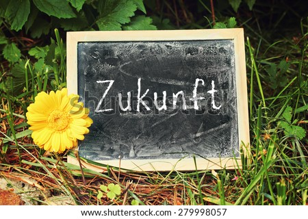 greeting card background for your text - blackboard - german  for future - stock photo