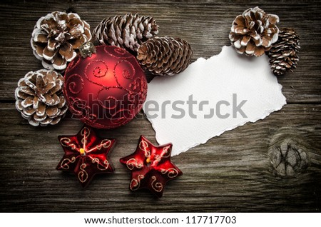 Greeting card for Christmas with red ball and candles on wooden top - stock photo