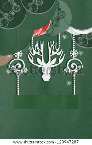 Greeting card on green with a beautiful white applique deer with large antlers amongst delicate swirled decorations and balls with copyspace for your Christmas or seasonal greeting - stock photo