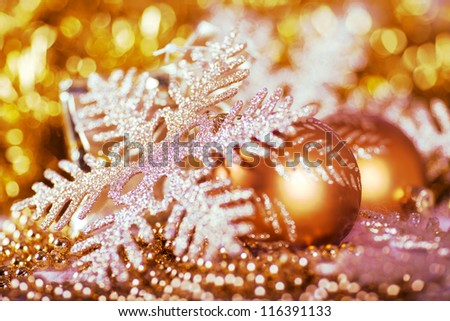 Greeting card with Christmas ball and snowflake in gold design - stock photo