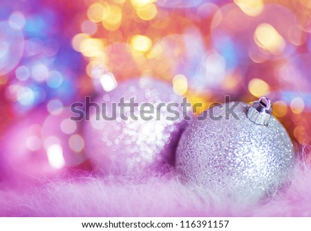 Greeting card with silver Christmas balls on colorful background - stock photo