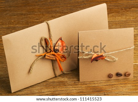greeting cards and envelopes handmade. on a wooden table - stock photo