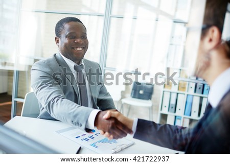 Greeting new colleague - stock photo