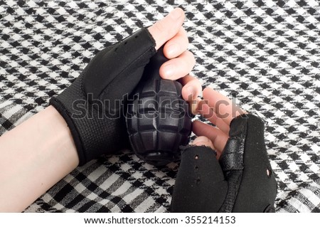 grenade in hands - stock photo