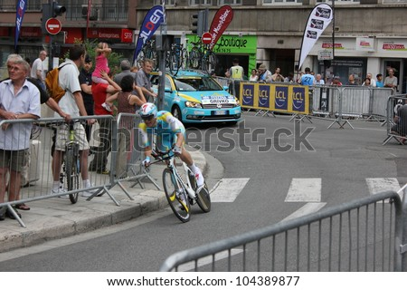 """GRENOBLE, FRANCE - JUN 3: Professional racing cyclist Andriy Grivko rides UCI WORLD TOUR """"CRITERIUM DU DAUPHINE LIBERE"""" time trial on June 3, 2012 in Grenoble, France. Luke Durbridge wins the stage. - stock photo"""