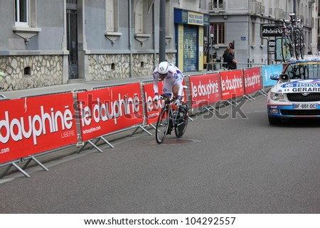 "GRENOBLE, FRANCE - JUN 3: Professional racing cyclist Arnaud Gerard rides UCI WORLD TOUR "" CRITERIUM DU DAUPHINE LIBERE"" time trial on June 3, 2012 in Grenoble, France. Luke Durbridge wins the stage. - stock photo"