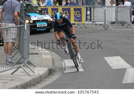 "GRENOBLE, FRANCE - JUN 3: Professional racing cyclist Danny Pate rides UCI WORLD TOUR ""CRITERIUM DU DAUPHINE LIBERE"" time trial on June 3, 2012 in Grenoble, France. Luke Durbridge wins the stage - stock photo"
