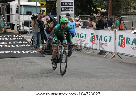 """GRENOBLE, FRANCE - JUN 3: Professional racing cyclist G. Bernaudeau  rides UCI WORLD TOUR """"CRITERIUM DU DAUPHINE LIBERE""""  time trial on June 3, 2012 in Grenoble, France. Luke Durbridge wins the stage - stock photo"""