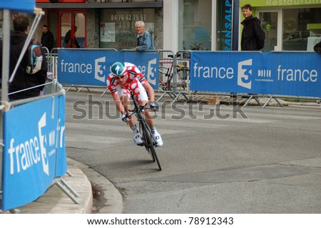 """GRENOBLE, FRANCE - JUN 8: Professional racing cyclist Jurgen Van den Broeck rides UCI WORLD TOUR """" CRITERIUM DU DAUPHINE LIBERE"""" third stage time trial on June 8, 2011 in Grenoble city, Isere, France. - stock photo"""