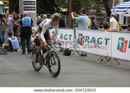 """GRENOBLE, FRANCE - JUN 3: Professional racing cyclist Mikael Cherel rides UCI WORLD TOUR """"CRITERIUM DU DAUPHINE LIBERE""""  time trial on June 3, 2012 in Grenoble, France. Luke Durbridge wins the stage - stock photo"""