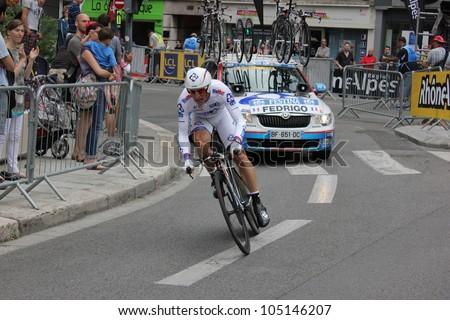"GRENOBLE, FRANCE - JUN 3: Professional racing cyclist Pierrick Fadrigo rides UCI WORLD TOUR ""CRITERIUM DU DAUPHINE LIBERE"" time trial on June 3, 2012 in Grenoble, France. Luke Durbridge wins the stage - stock photo"