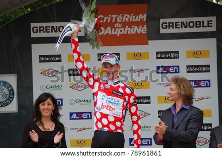 """GRENOBLE, FRANCE - JUNE 8: Professional racing cyclist Jurgen Van Den Broeck wears spotted jersey of UCI WORLD TOUR """" CRITERIUM DU DAUPHINE LIBERE"""" time trial on June 8, 2011 in Grenoble, Isere France - stock photo"""