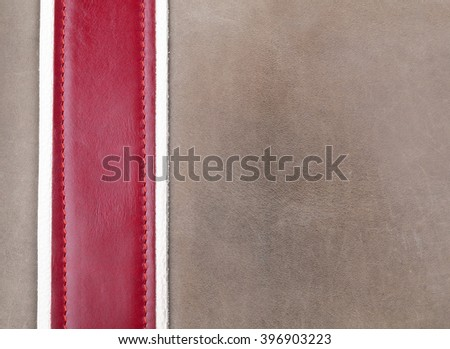 Grey and red leather stitched with copy space - stock photo
