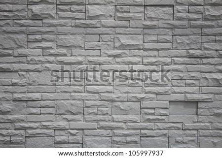 Grey brick stone wall. - stock photo