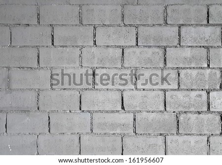 grey brick wall for background or texture  - stock photo