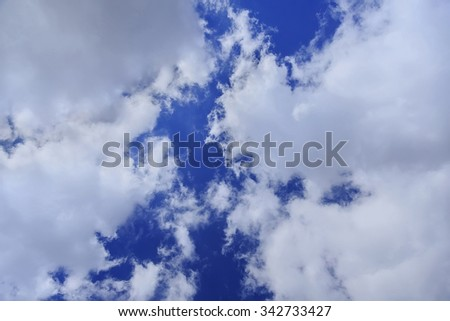 Grey clouds in blue sky, day - stock photo