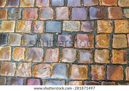 Grey cobblestone pavement after the rain in the Czech Republic - stock photo