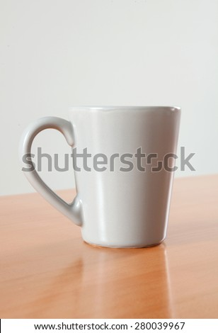Grey cup for breakfast on a wooden table  - stock photo
