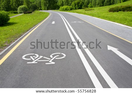 grey cycle track with white sign - stock photo
