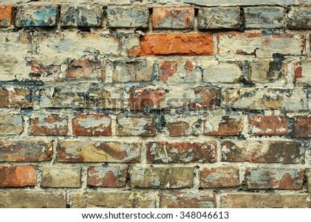 Grey damaged peeled brick wall texture background. Close up. Vintage effect.  - stock photo