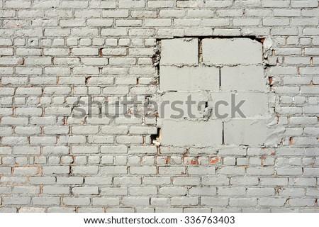 grey painted brick wall - stock photo