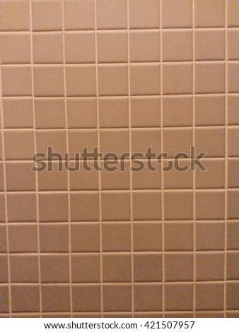 Grey pink square wall tiles for a bathroom - stock photo