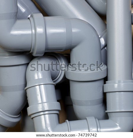 Grey PVC sewer pipes  background - stock photo