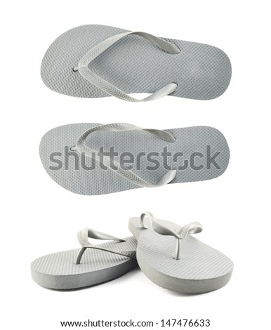 Grey rubber flip-flops isolated over white background, set of two foreshortenings - stock photo
