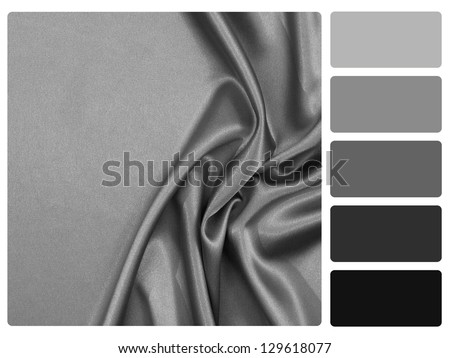 Grey satin color palette with complimentary swatches. - stock photo