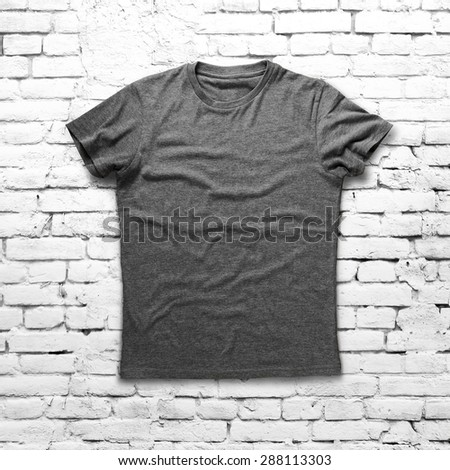 Grey shirt over brick background - stock photo