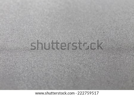 Grey silver metallic glitter shiny modern cold industrial textured background with selective focus - stock photo