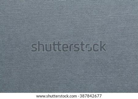 Grey stamped cardboard texture. Grey background. - stock photo