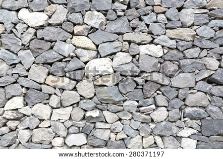 Grey stone wall as background - stock photo