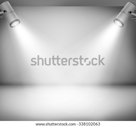 Grey studio and two spotlights - stock photo