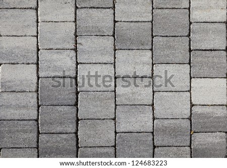 grey tiles give a harmonic pattern at the ground - stock photo