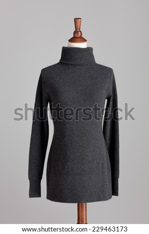 grey woman cashmere sweater with wood model on grey isolated - stock photo