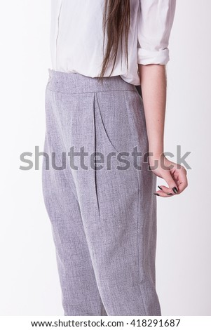 Grey women trousers,Focus on trousers. - stock photo