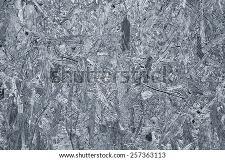 Grey wood chipboard as background - stock photo