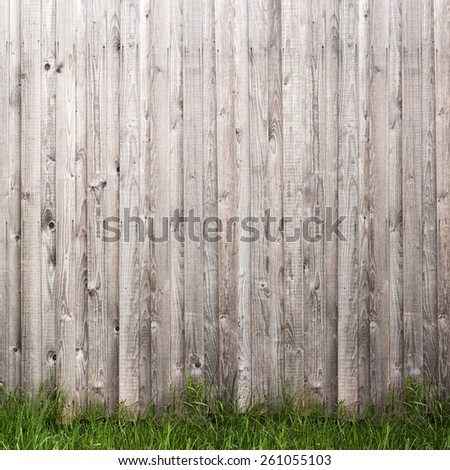 grey wooden plank wall and grass  background - stock photo