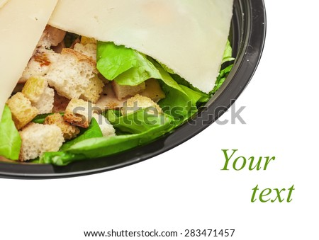 Griddled chicken caesar salad covered with cheese slices parmesan isolated on white background - stock photo