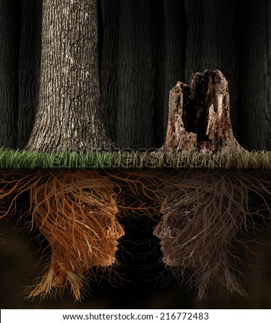 Grief And Grieving concept as two trees with roots shaped as human heads with one dead tree in a forest as a symbol for loss and a metaphor for spirituality in mourning a loved one that has died. - stock photo
