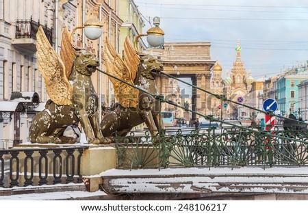 Griffon sculpture of Bank bridge in St.Peterburg. Focus on Griffon - stock photo