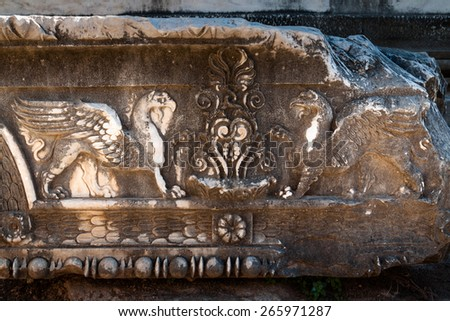 Griffons, carved in stone of ancient temple, Didyma, Turkey - stock photo