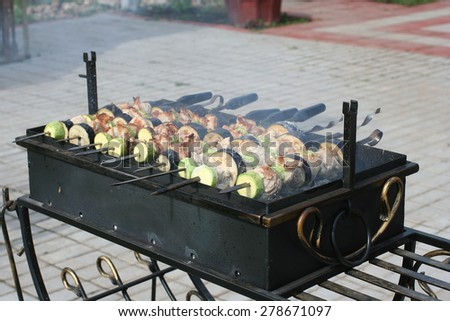 grill with kebab cooking on it - stock photo